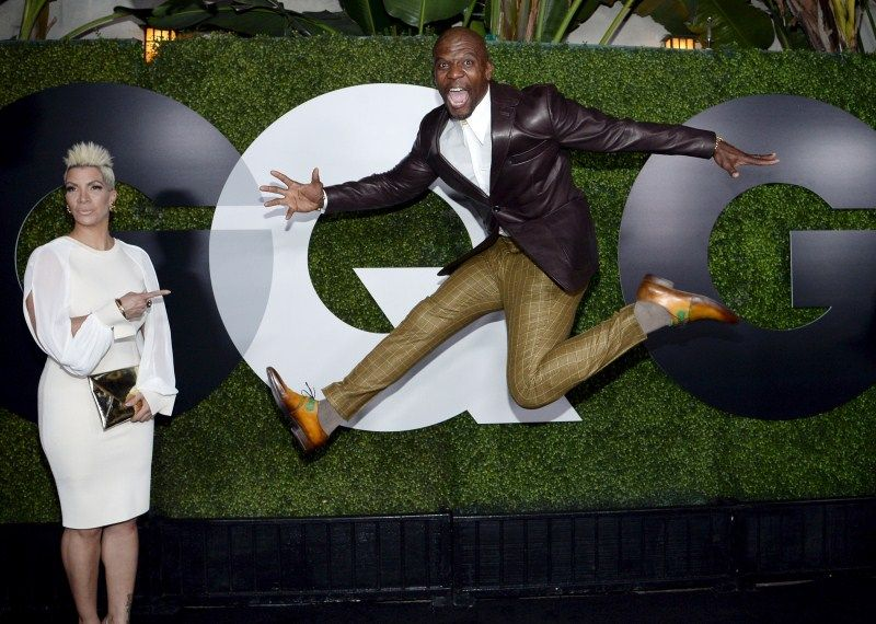 Rebecca King-Crews and Terry Crews, who is wearing plaid pants and leather sports coat