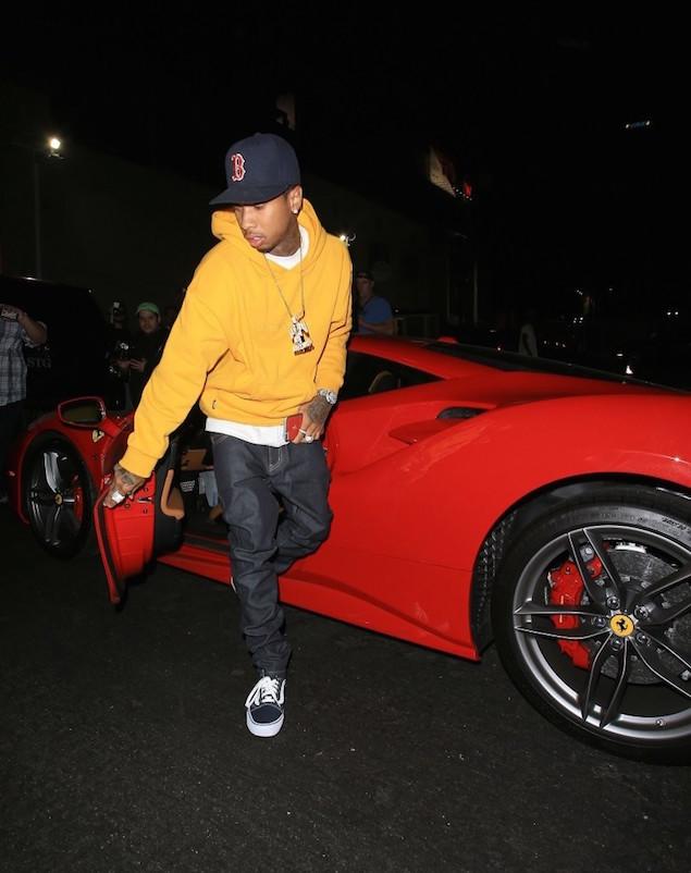 Tyga-Hops-Out-Of-His-Ferrari-wearing-Gosha-Rubchinskiy-Yellow-Hoodie-2
