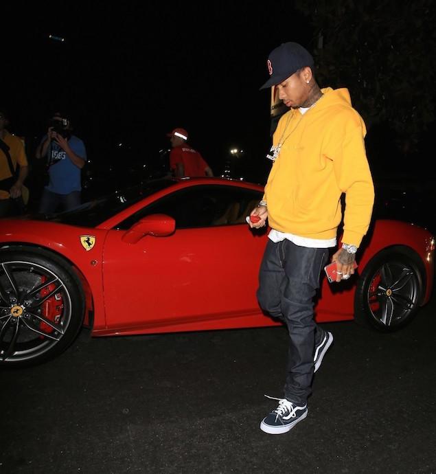 Tyga-Hops-Out-Of-His-Ferrari-wearing-Gosha-Rubchinskiy-Yellow-Hoodie