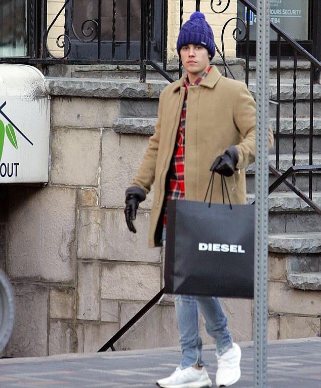 justin-bieber-diesel-coat-hat-fear-of-god-jeans-adidas-sneakers-2