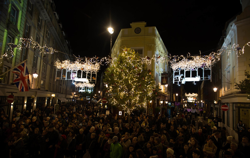 EDITORIAL USE ONLY Crowds gather in preparation for the woodland themed Seven Dials Christmas lights switch on that features 250 twinkling Christmas animals, and coincides with an exclusive traffic free festive shopping event, in London. PRESS ASSOCIATION Photo. Picture date: Thursday November 17, 2016. Designed by James Glancy Design, the Christmas light installation consists of 190 silver birch trees with sparkling LED branch lights, and inhabits a stag, polar bear, brown bear, foxes, arctic wolf, badger, squirrels, rabbits, hedgehogs, owl, robins and blue-tits. Photo credit should read: David Parry/PA Wire