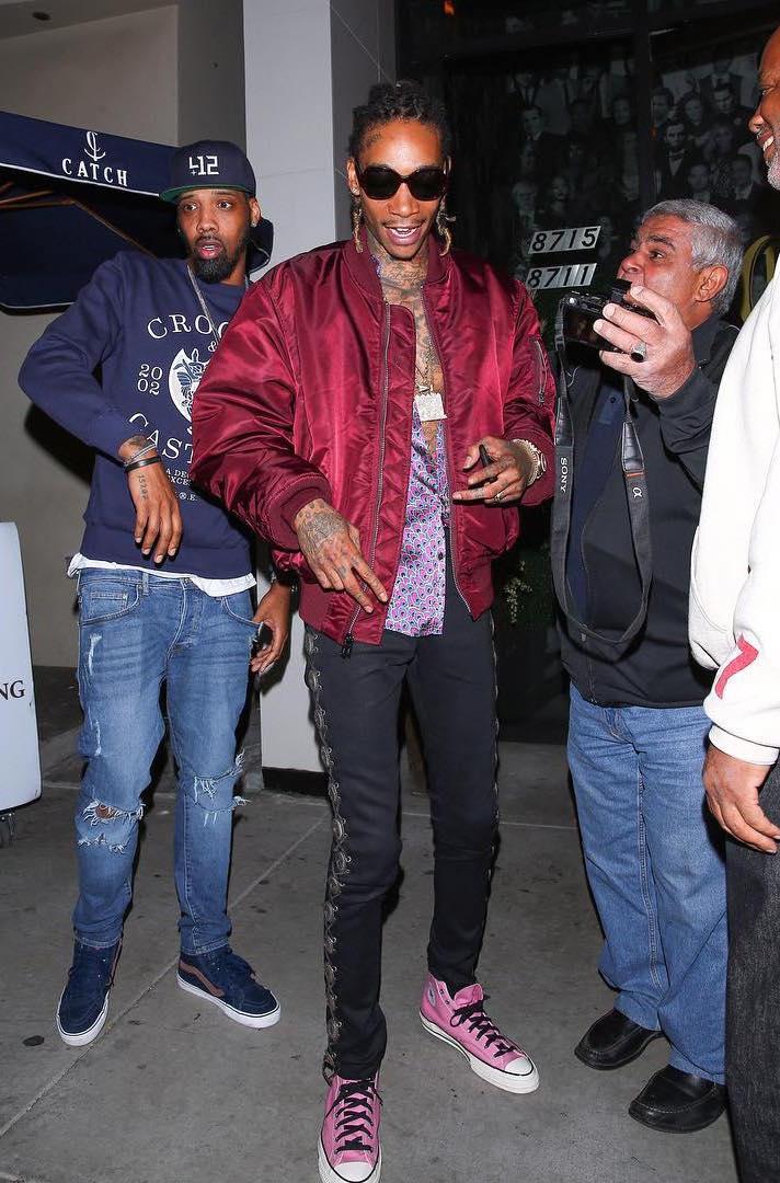 wiz-khalifa-alpha-industries-jacket-saint-laurent-jeans-converse-sneakers