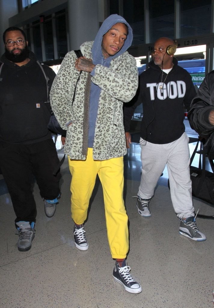 wiz-khalifa-gosha-rubchinskiy-coat-converse-sneakers-saint-laurent-backpack-2