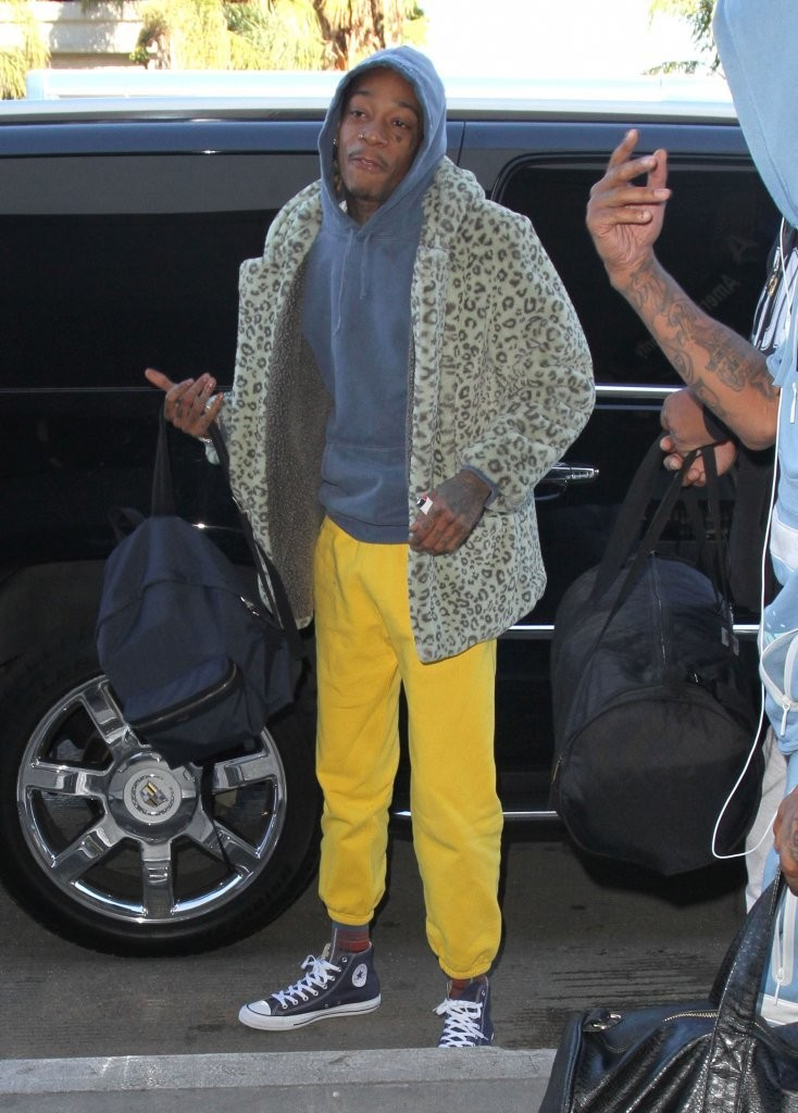 wiz-khalifa-gosha-rubchinskiy-coat-converse-sneakers-saint-laurent-backpack